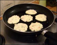 Korean Pancakes Frying in a pan